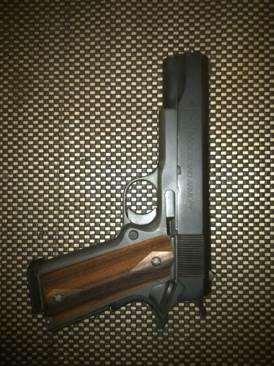 1911 Gun - Armscor/RIA (Semi-automatic Pistol) front image (front cover)