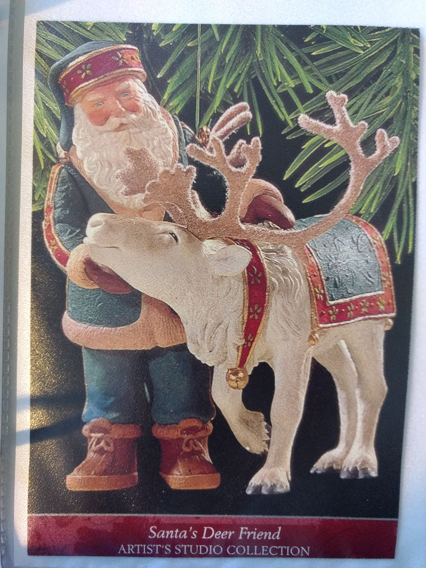 Santa - Santa's Deer Friend Ornament - Hallmark front image (front cover)