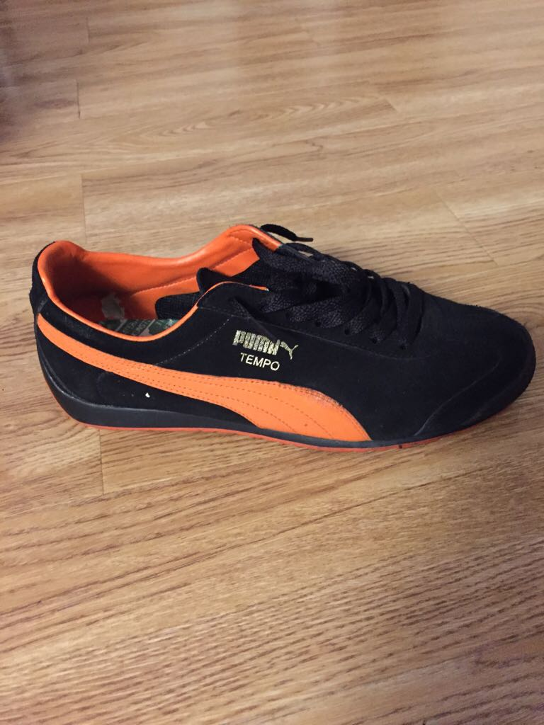 black and orange puma shoes