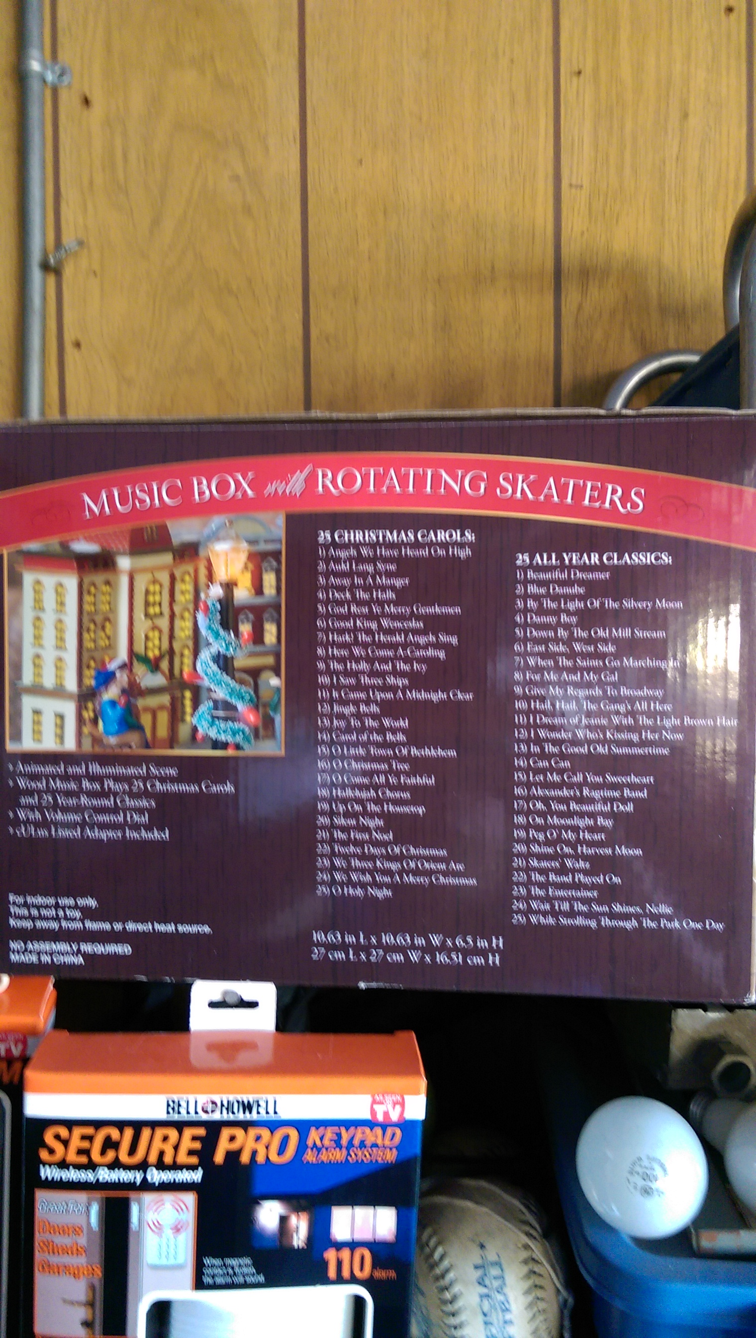 Kirkland Signature Music Box with Rotating Skaters Snowglobe - USA back image (back cover, second image)