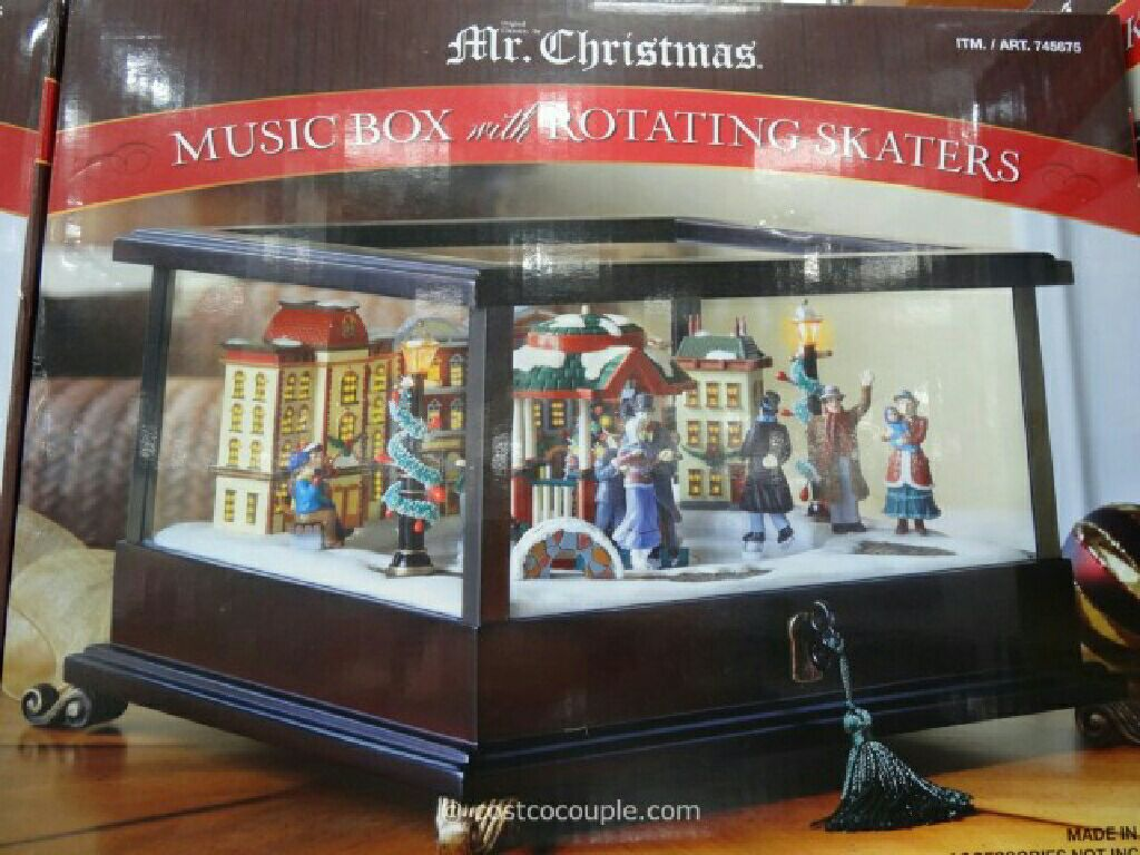 Kirkland Signature Music Box with Rotating Skaters Snowglobe - USA front image (front cover)