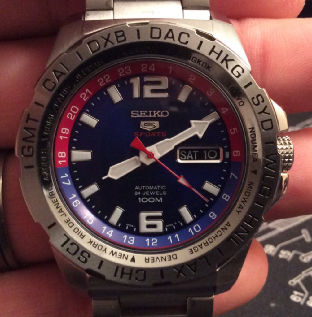 """Seiko 5 Sports SRP681 Men's Stainless Steel Blue Dial World Time Automatic Watch Watch - Seiko (Ref. SRP681K1 """"World Timer"""") front image (front cover)"""